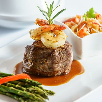 Filet of beef with tender shrimp and pasta Room Service